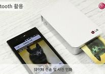 Pouces levés pour l'imprimante portable photo Android de LG