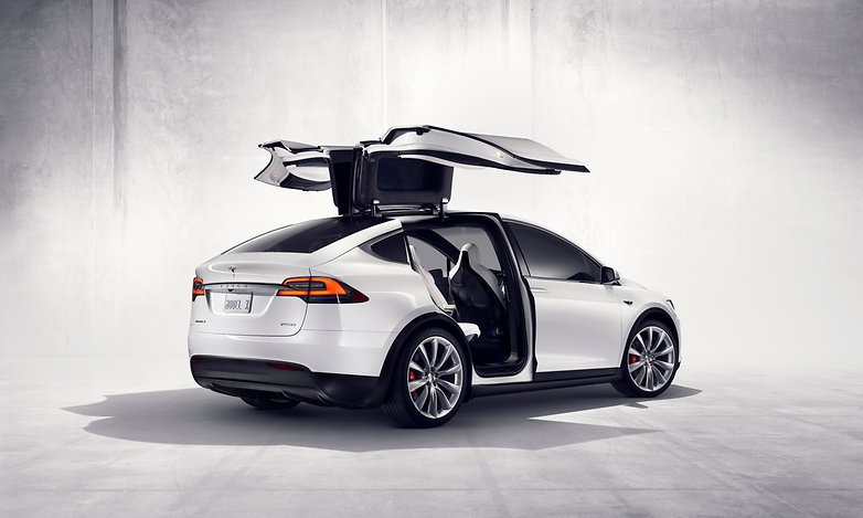 press00 model x rear three quarter with doors open